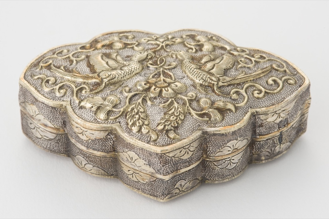 Fan-shaped box with parrot and duck decoration, Tang dynasty, ca. 825-50. Photo by Asian Civilisations Museum, Tang Shipwreck Collection. Courtesy of Asia Society Museum.