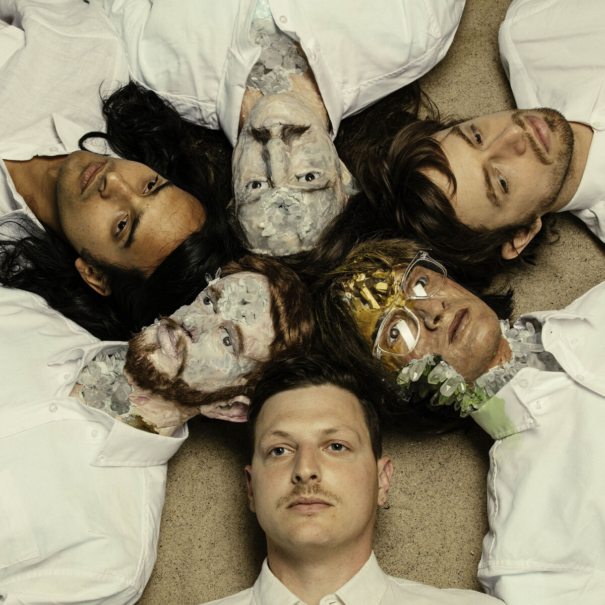 Members of Yeasayer with sculptures by David Altmejd. Photo courtesy of We    Are    Free.