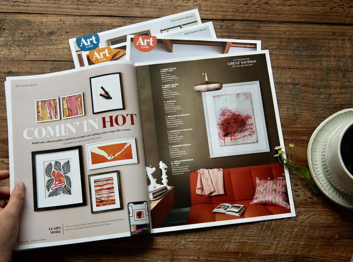 A customer shops an Art.com catalogue. Photo courtesy Walmart.