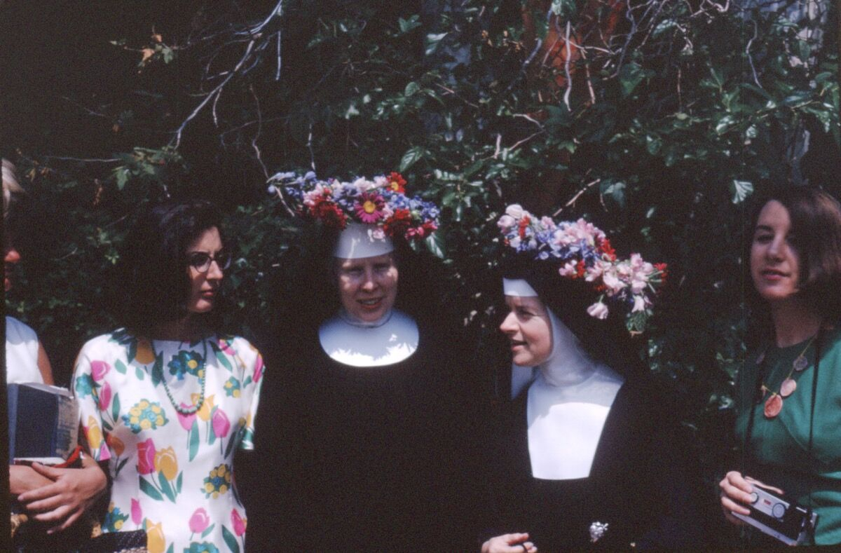 Corita (center right) at Immaculate Heart College Mary's Day celebration, 1964. Image courtesy of the Corita Art Center, Immaculate Heart Community, Los Angeles.