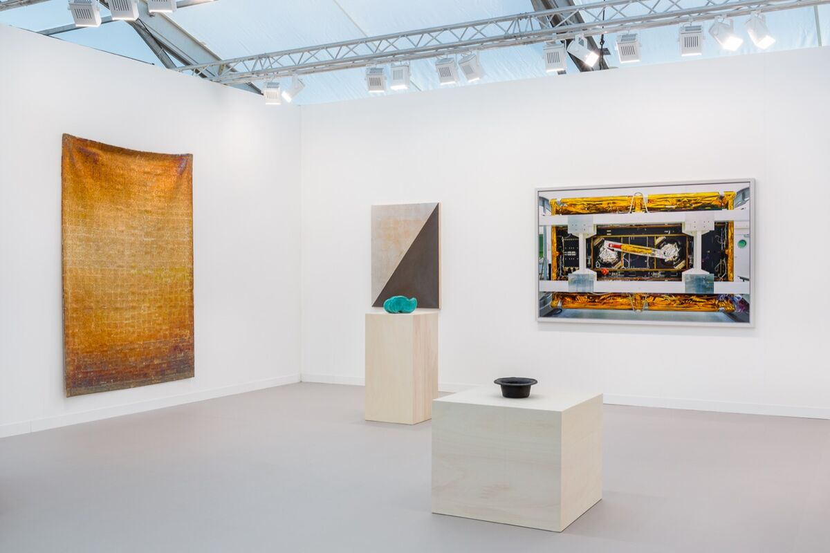 Installation view of work by Edith Dekyndt, Jean-Luc Moulène, and Thomas Struth at Galerie Greta Meert's booth at Frieze London, 2018. Courtesy of the gallery.
