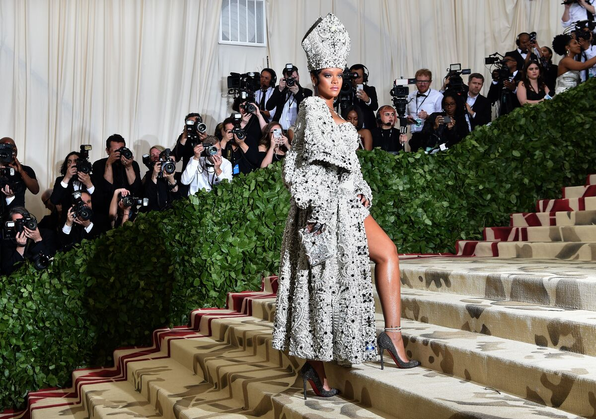 "Rihanna arrives for the 2018 Met Gala on May 7, 2018, at the Metropolitan Museum of Art in New York. The Gala's 2018 theme is ""Heavenly Bodies: Fashion and the Catholic Imagination."" Photo by Hector Retamal/AFP/Getty Images."