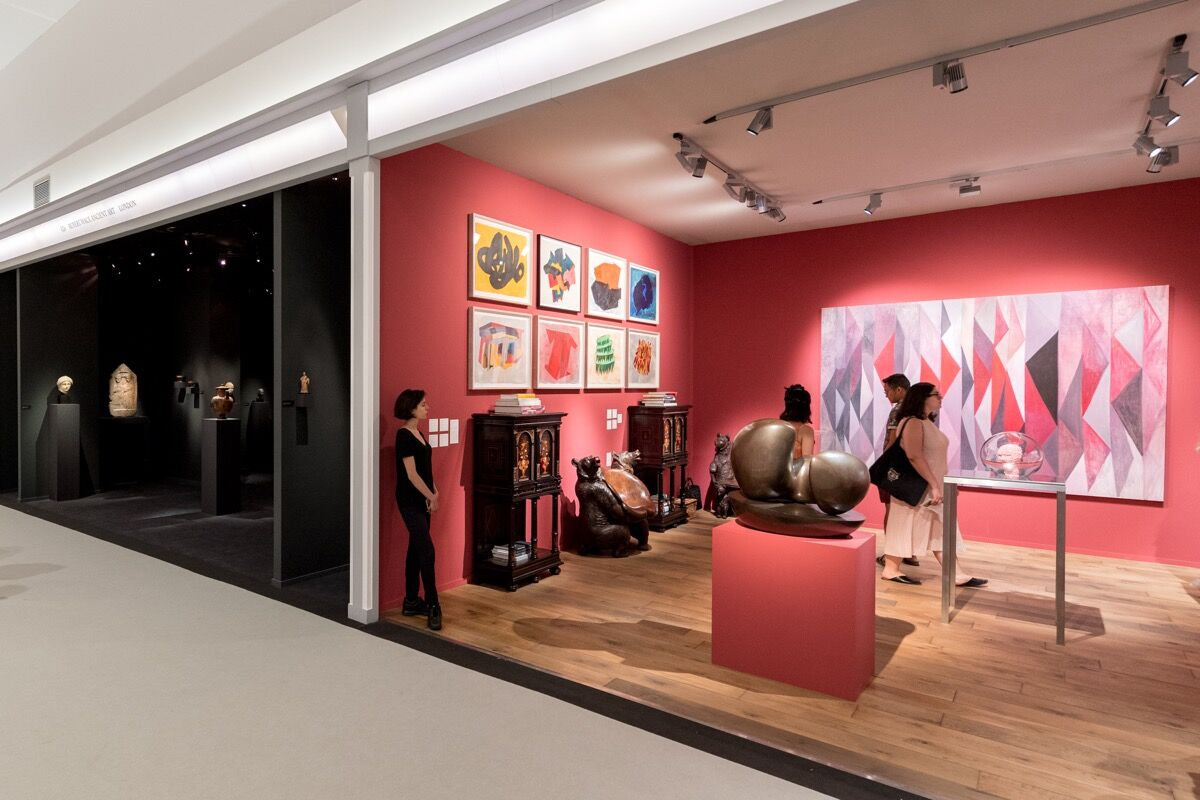 Left to right: Installation view of Rupert Wace Ancient Art and Hauser & Wirth's booths at Masterpiece London 2018. Photo by Ben Fisher. Courtesy of Masterpiece London 2018.