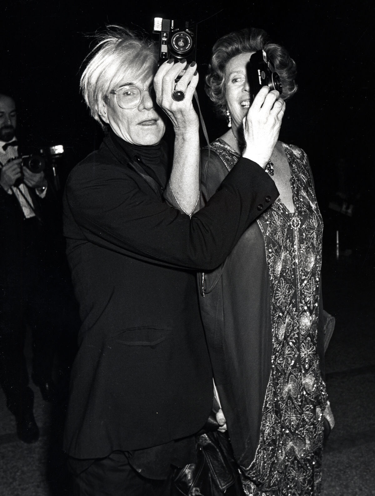 """Andy Warhol and Princess Mani Sayn von Witgenstein at the """"14th Annual Diana Vreeland Costume Exhibit Dance,"""" at the Metropolitan Museum of Art, New York, 1985. Photo by Ron Galella/WireImage"""