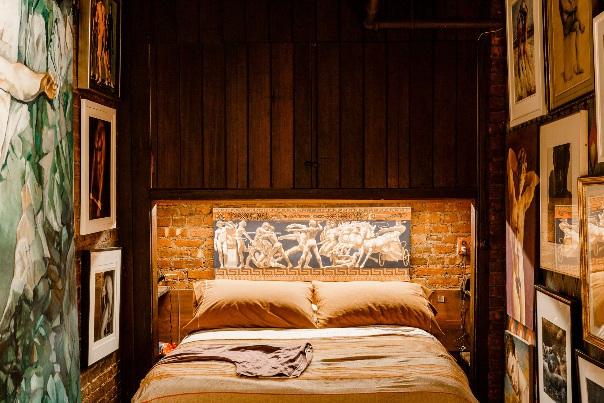 A Greek-inspired frieze by James Childs (2004) decorates the bed in the guest room. On the left, Andrew Sichel's Before Time Changes Them (1970), which Leslie purchased when it was rejected from the artist's thesis exhibition. Photo by Max Burkhalter for Artsy.