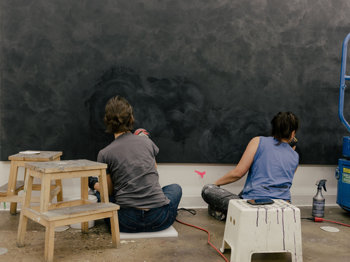 Studio assistants at work in Julie Mehretu's Chelsea studio. Photo by Daniel Dorsa for Artsy.
