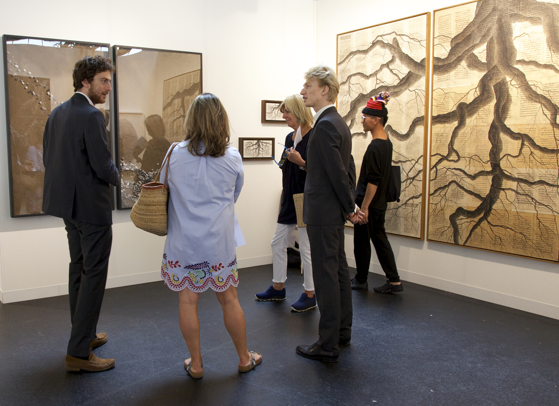 Tancrède Hertzog (left) and Léopold Legros (center), co-owners of Galerie T&L (Paris) hold court in a solo booth project by Tindar; courtesy VOLTA13