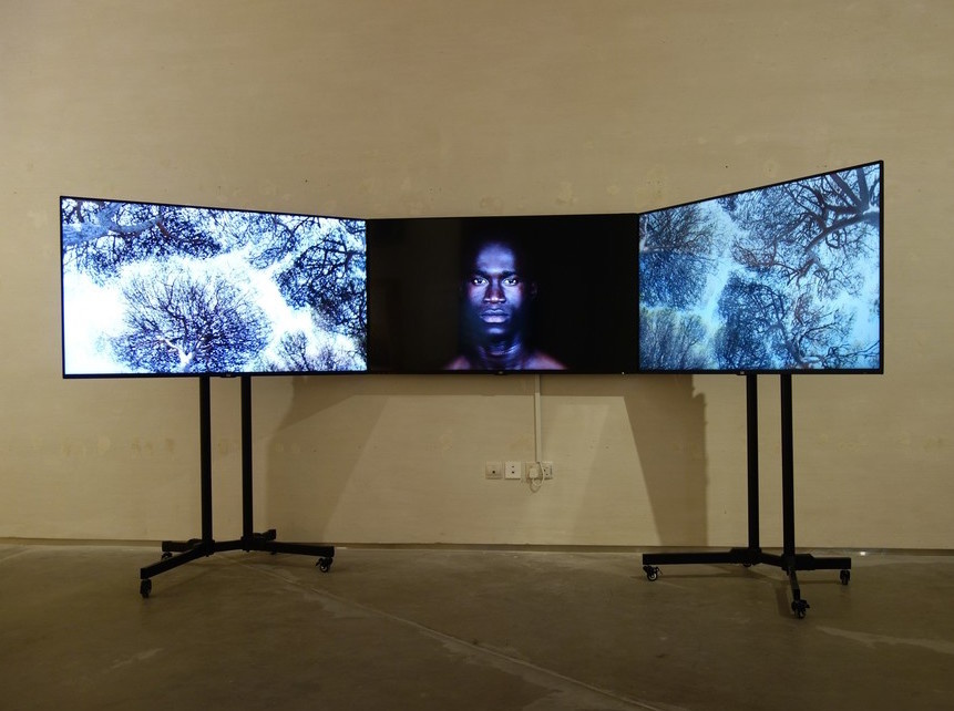"""Installation view of Leila Alaoui's Crossings, on view for """"If I Leave, Where Will I Go"""" at East Wing. Courtesy of the gallery."""