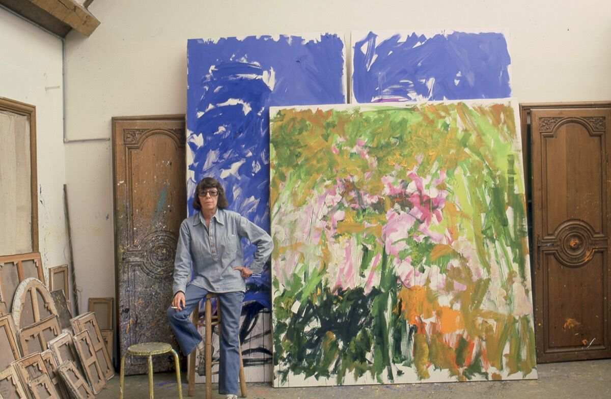 Joan Mitchell in her Vétheuil studio, 1983. © Joan Mitchell Foundation. Photo by Robert Freson, Joan Mitchell Foundation Archives. Courtesy of David Zwirner New York/London/Hong Kong.