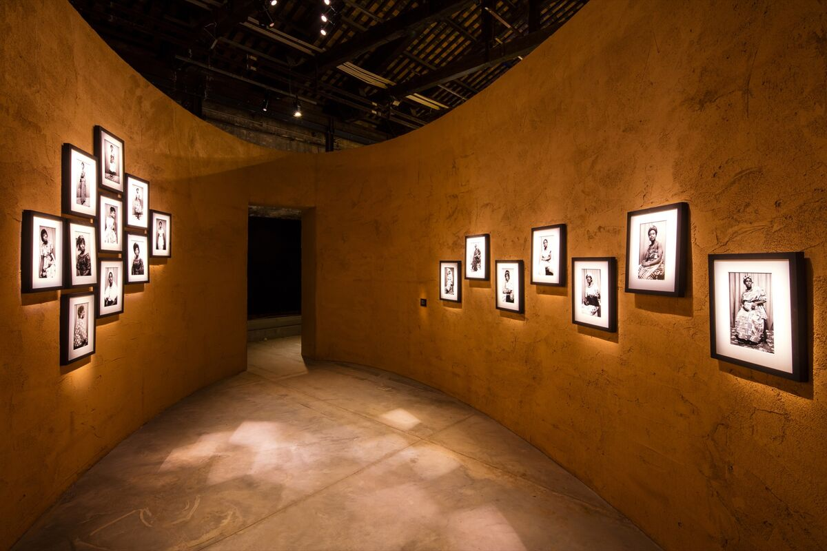 """Installation view of the Ghana Pavilion, """"Ghana Freedom,"""" featuring Felicia Abban, Untitled (Portraits and Self-Portraits), c. 1960–70s, at the 58th Venice Biennale, 2019. Photo by David Levene. Courtesy of the artist."""