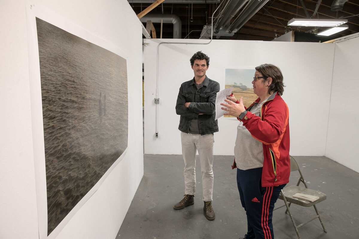Artist Catherine Opie speaks to a student during an open studio at UCLA. Photo by Reed Hutchinson. Courtesy of UCLA.