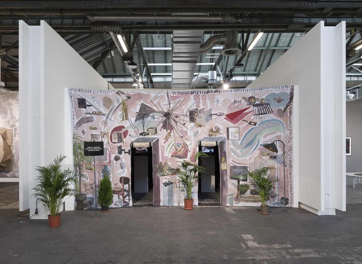 Installation view of Laure Prouvost's behind the lobby doors, the pepper is in the right eye at Carlier | Gebauer's booth at Art Berlin Contemporary, 2016. Photo by Trevor Good, courtesy of Carlier | Gebauer.