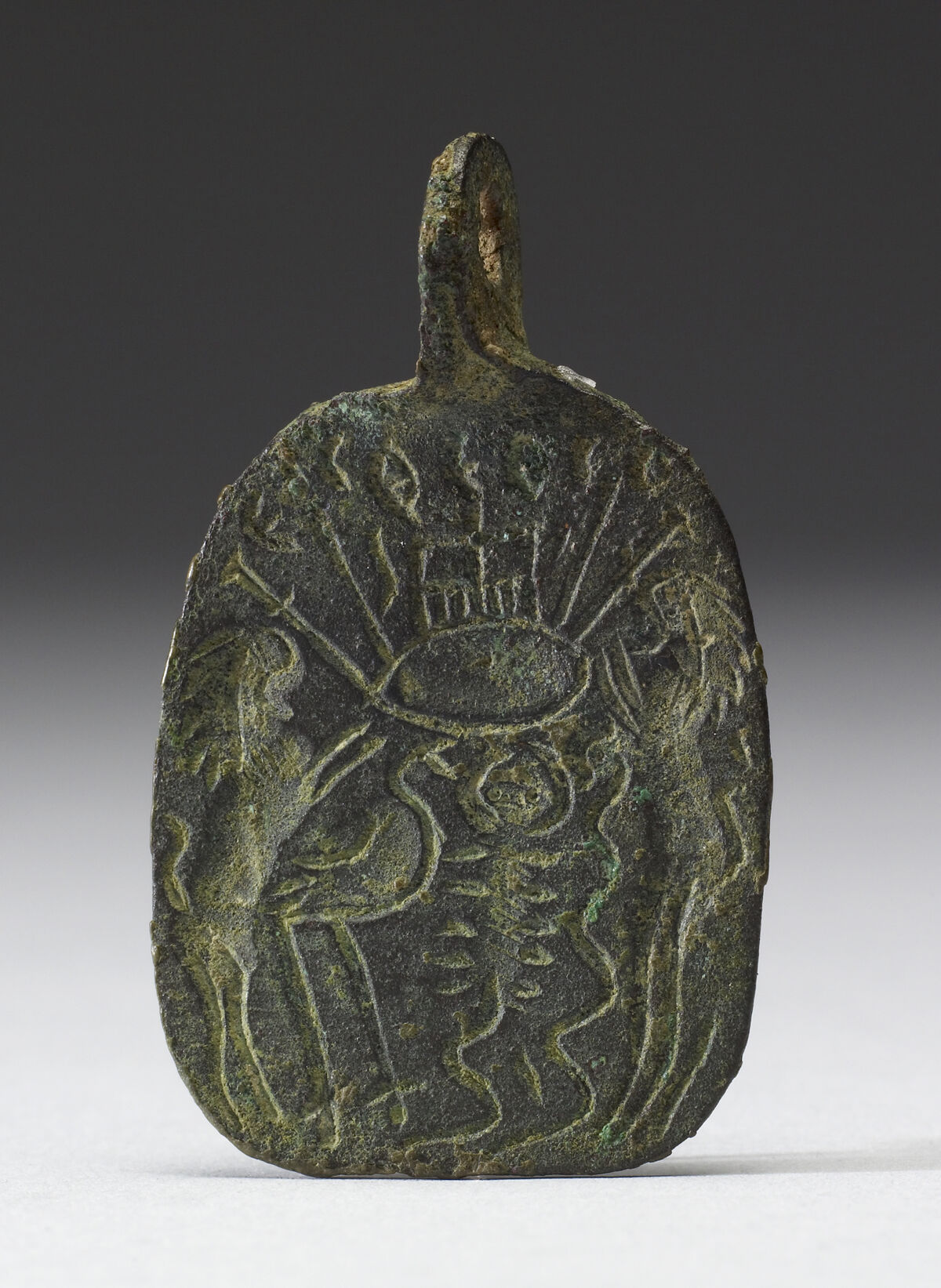 """Amuletic Pendant from the Byzantine Empire with the inscription, """"[The] one God overcomes the evil,"""" 5th century. Photo via the Walters Art Museum."""