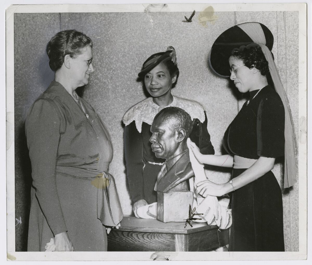 Augusta Savage with Ernestine Rose, Roberta Bosley Hubert, and her sculpture James Weldon Johnson, 1939. Courtesy of the Schomburg Center for Research in Black Culture, NYPL.