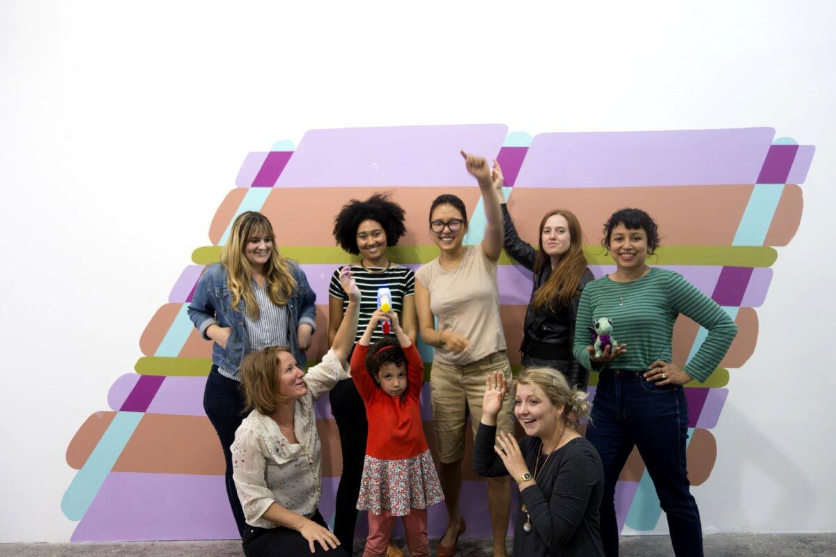 Clockwise from upper left: Danielle Genzel, Lukaza Branfman-Verissimo, YeRin Kim, Erica Molesworth, Maria Guzmán Capron, Addy Rabinovitch, Petra Guzmán Capron (Maria's daughter), and Sara Kerr in front of Kico Le Strange aka Marco Garcia's residency installation The Daddy I Don't Have Yet. Photo courtesy of CTRL+SHFT.