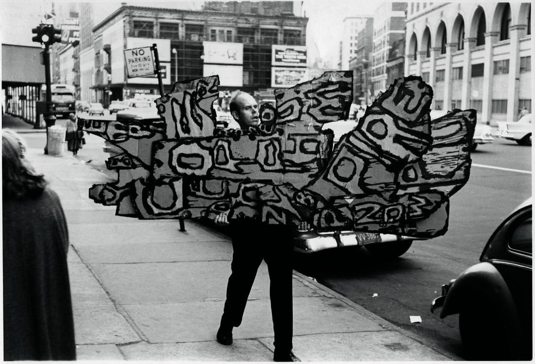 Untitled (Claes Oldenburg carrying Street Sign I to the Reuben Gallery, New York, 1960). Photograph by I.C. Rapoport. Courtesy Oldenburg van Bruggen Studio. Artwork © 1960 Claes Oldenburg. Image courtesy of Grey Art Gallery.
