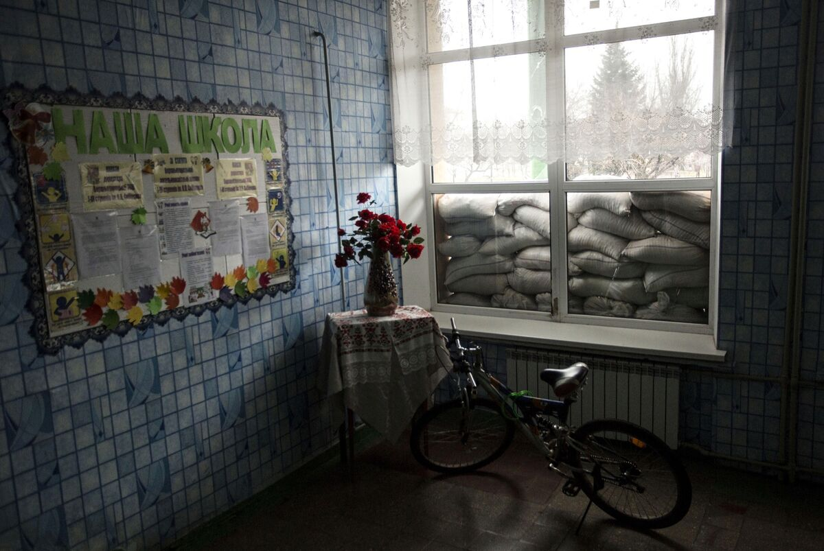 A view of a school window blocked with sandbags to protect from shelling in Verkhnyotoretske, Donetsk, Ukraine, on November 28, 2016. Photo by Anastasia Vlasova. Courtesy of the artist.