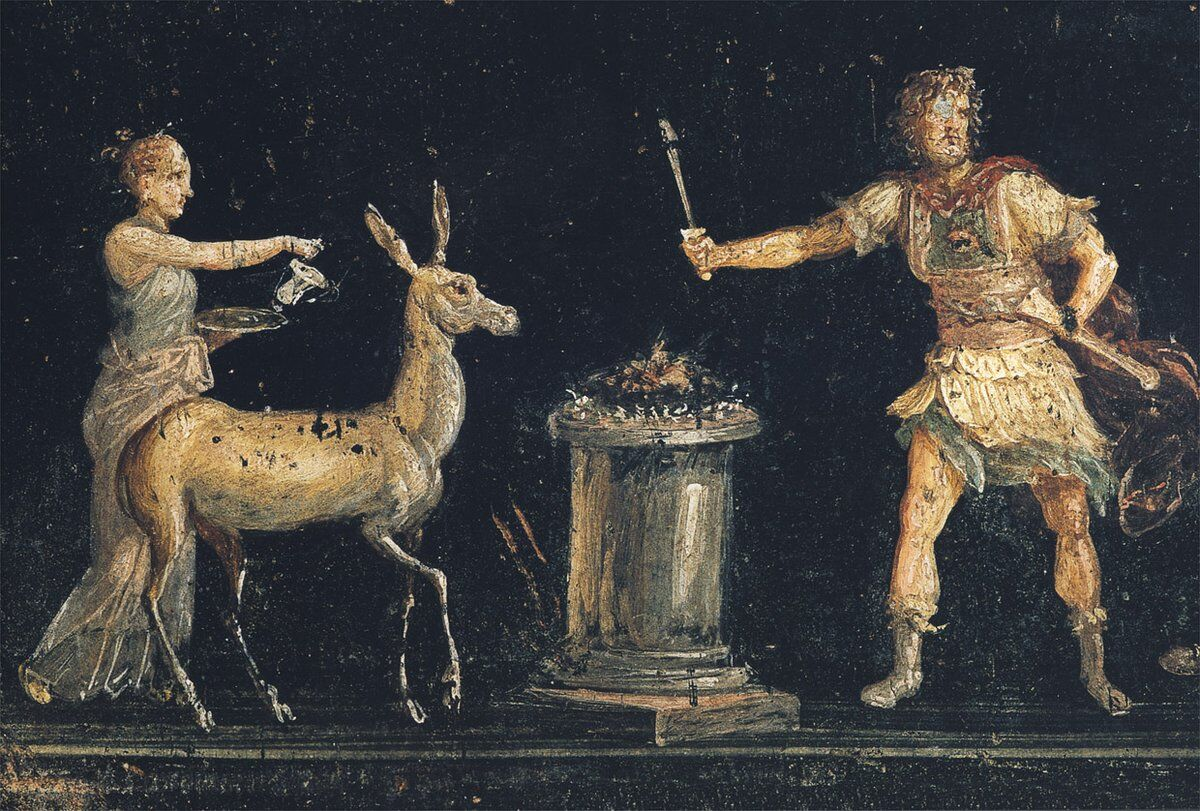 Fresco depicting a scene of sacrifice in honor of the goddess Diana in the triclinium of the House of the Vettii, Pompeii. Photo via Wikimedia Commons.