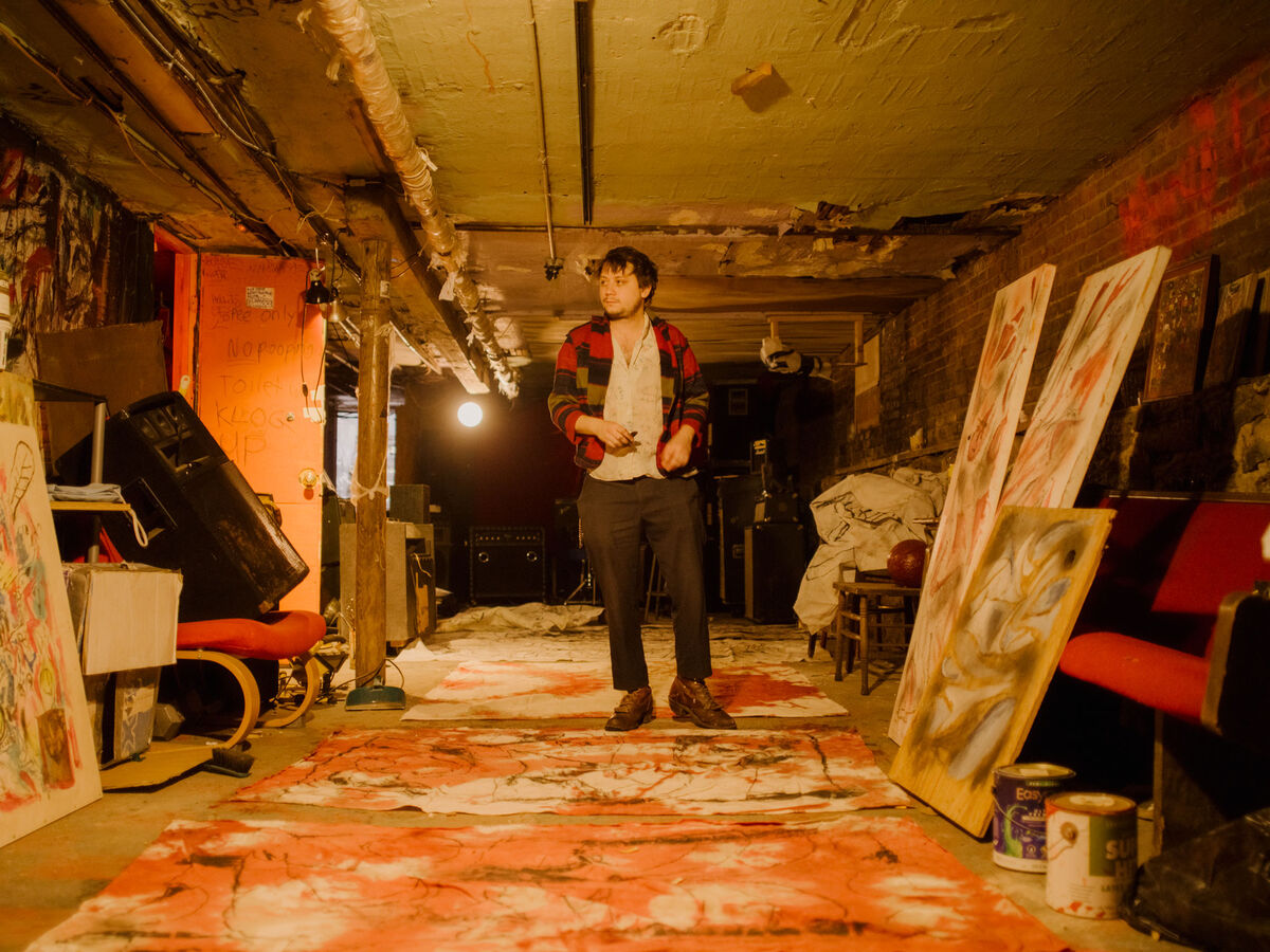 Dean Cercone spreads his paintings out on the floor of his basement studio—a little extra dirt is part of the process. Photo by Heather Sten for Artsy.
