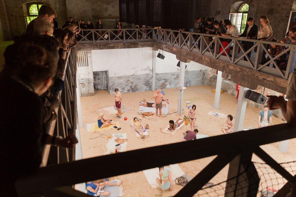 "Installation view of Rugilė Barzdžiukaitė, Vaiva Grainytė, and Lina Lapelytė, ""Sun & Sea (Marina),"" 2019, for the Lithuania Pavilion at the 58th Venice Biennale, 2019. Photo © Andrej Vasilenko. Courtesy of Miles Evans PR."