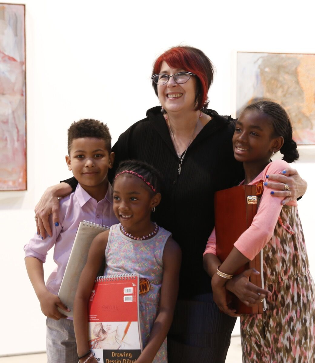 Cyndie Berthezene with Time In students. Photo courtesy of Time In Children's Arts Initiative.
