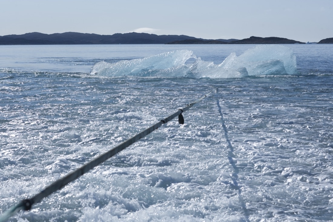 Towing the block of ice through Nuup Kangerlua, Greenland. Photo by Jørgen Chemnitz, courtesy of Olafur Eliasson.