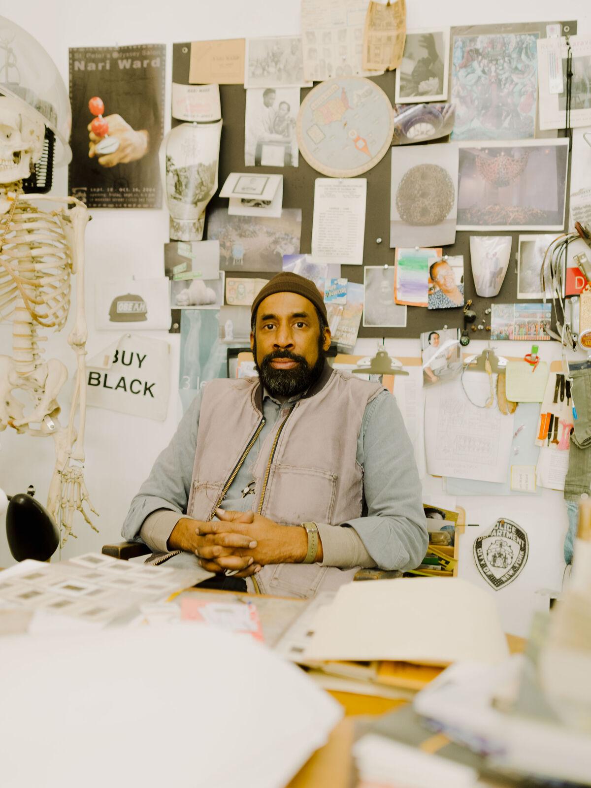 Portrait of Nari Ward in his studio by Heather Sten for Artsy.
