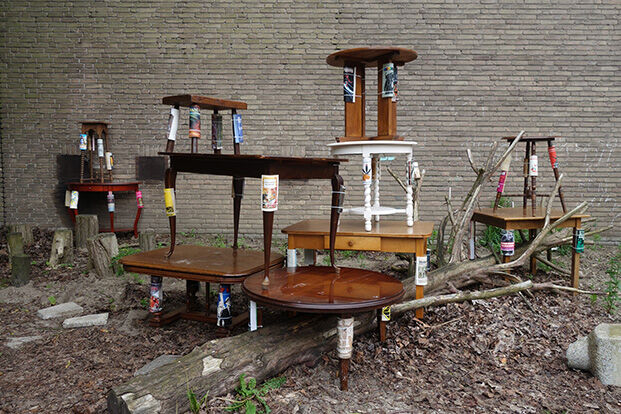 Mark Salvatus, Claws, 2016 Wooden tables, books, catnip, Dimensions variable