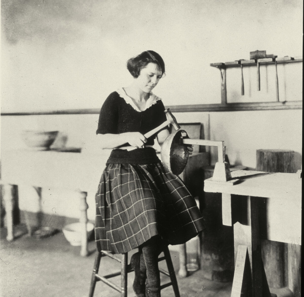 Newcomb College Student forming a metal bowl, c. 1920. Courtesy of the Newcomb Archives - Photo Archives Collection.