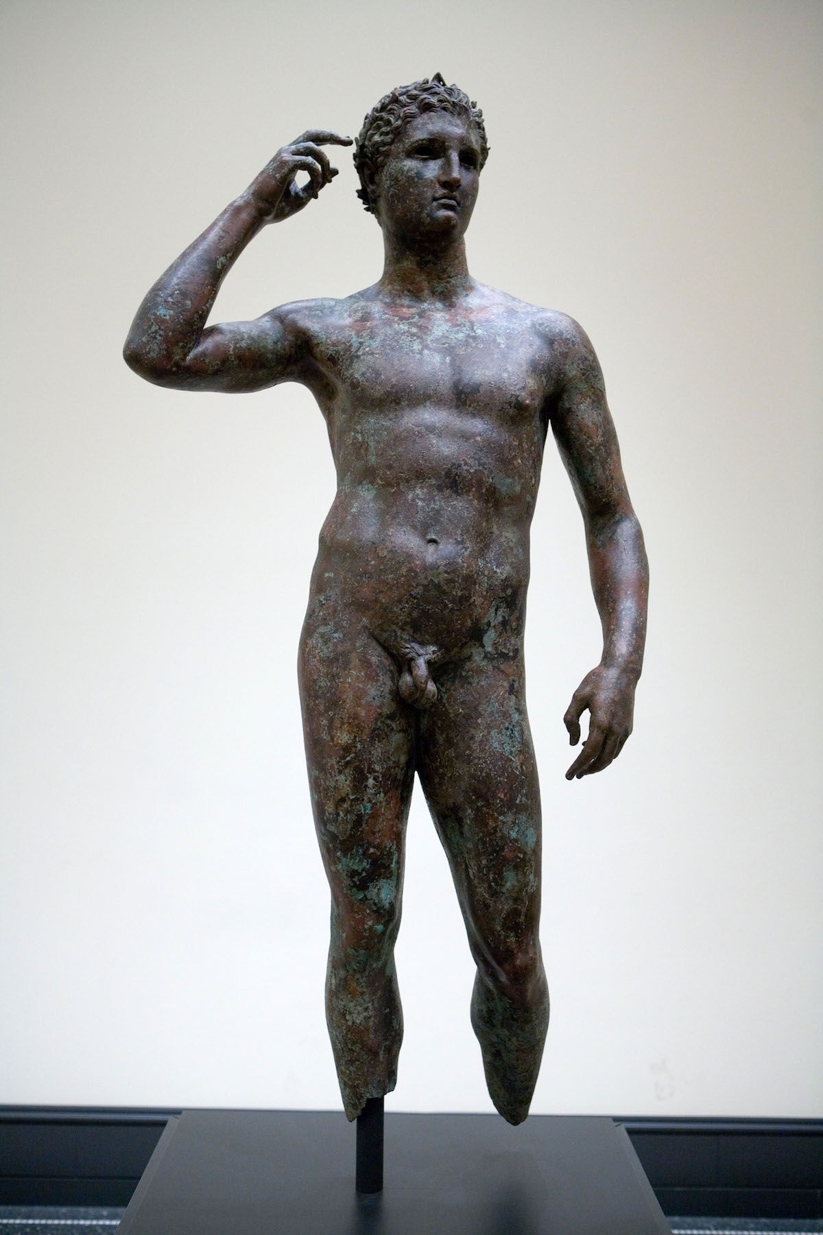 The ancient bronze statue known as Victorious Youth, or the Getty Bronze. Photo by Wtin, via Wikimedia Commons.