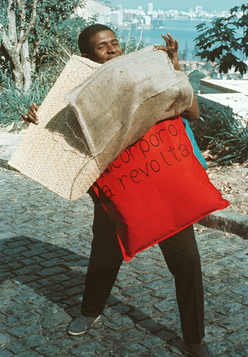 Hélio Oiticica, P15 Parangolé Cape 11, I Embody Revolt, worn by Nildo of Mangueira, 1967. Courtesy of César and Claudio Oiticica. Photo by Claudio Oiticica.