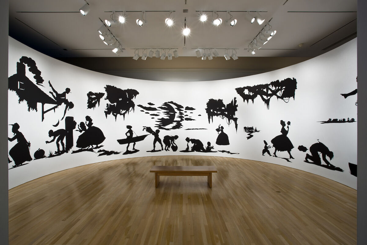 """Kara Walker, Slavery! Slavery! Presenting a GRAND and LIFELIKE Panoramic Journey into Picturesque Southern Slavery or """"Life at 'Ol' Virginny's Hole' (sketches from Plantation Life)"""" See the Peculiar Institution as never before! All cut from black paper by the able hand of Kara Elizabeth Walker, an Emancipated Negress and leader in her Cause, 1997, Hammer Museum, Los Angeles. Photo by Joshua White, © Kara Walker."""