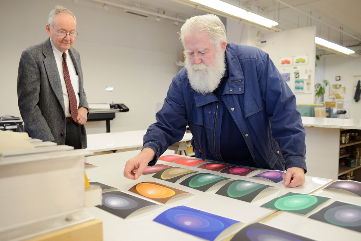Pace Prints President Dick Solomon with James Turrell at the Pace Editions printshop in Manhattan. The source images for the prints were photographs of the installation of Aten Reign at the Guggenheim Museum. Because the piece was composed of constantly shifting light, the artist had to select among hundreds of visible states to reference color for the prints. Courtesy Pace Prints.