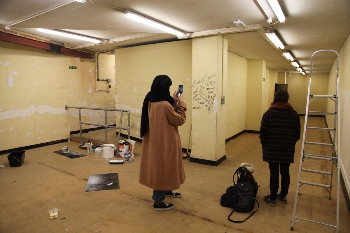 Artists Sarah Roberts and Katie Hayward exploring the vault at The Koppel Project. Photo courtesy of The Koppel Project.