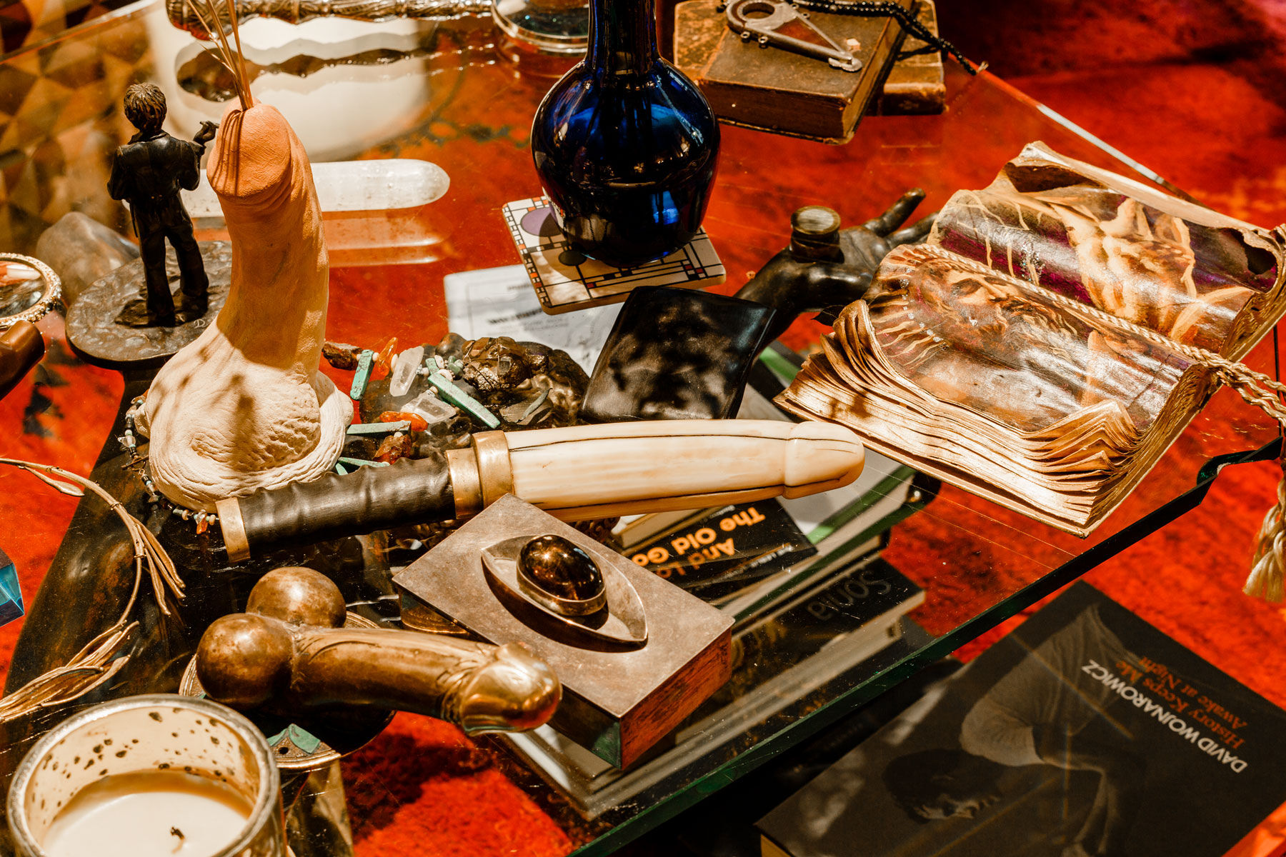 Charles Leslie's living room table features various crystal and ceramic penises as well as an ivory-and-brass dildo, or godemiché, from the Edo period in Japan. Photo by Max Burkhalter for Artsy.