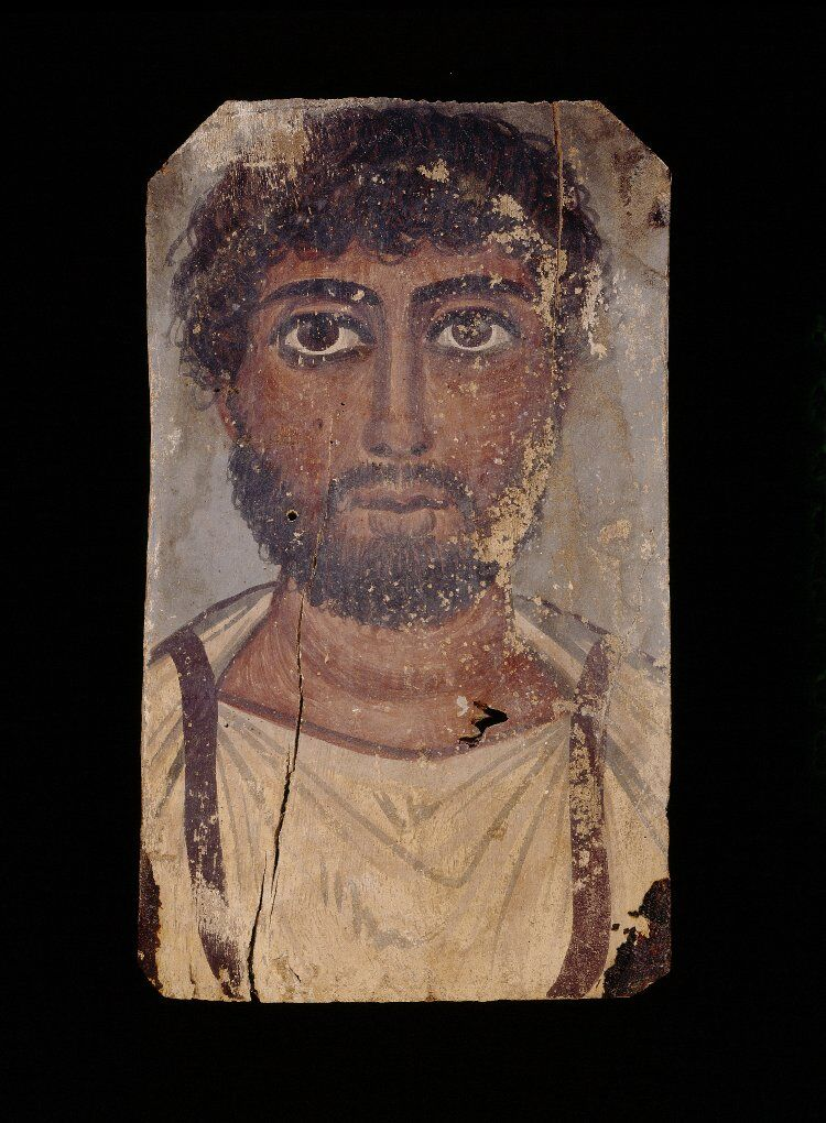 Oak panel bearing tempera portrait of a bearded man wearing a white tunic with purple clavi, 2ndC(early) Roman Period. Courtesy of the British Museum.