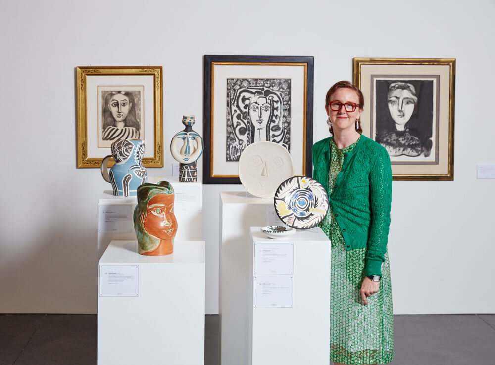 Kelly Troester seen here with a grouping of Pablo Picasso ceramics and prints