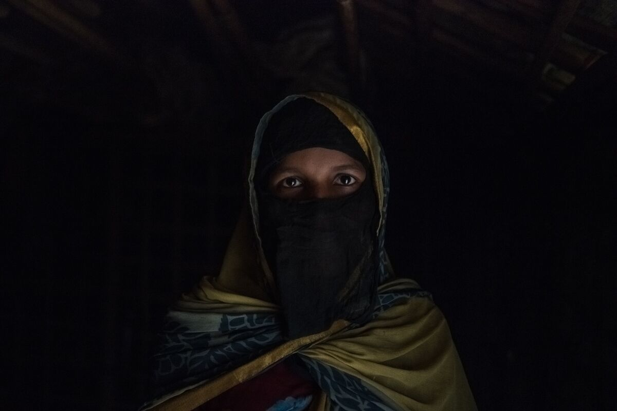 Noor, a Rohingya refugee, was gang-raped by soldiers in Myanmar. Photo by Rebecca Conway for the  New York Times . Courtesy of the artist.