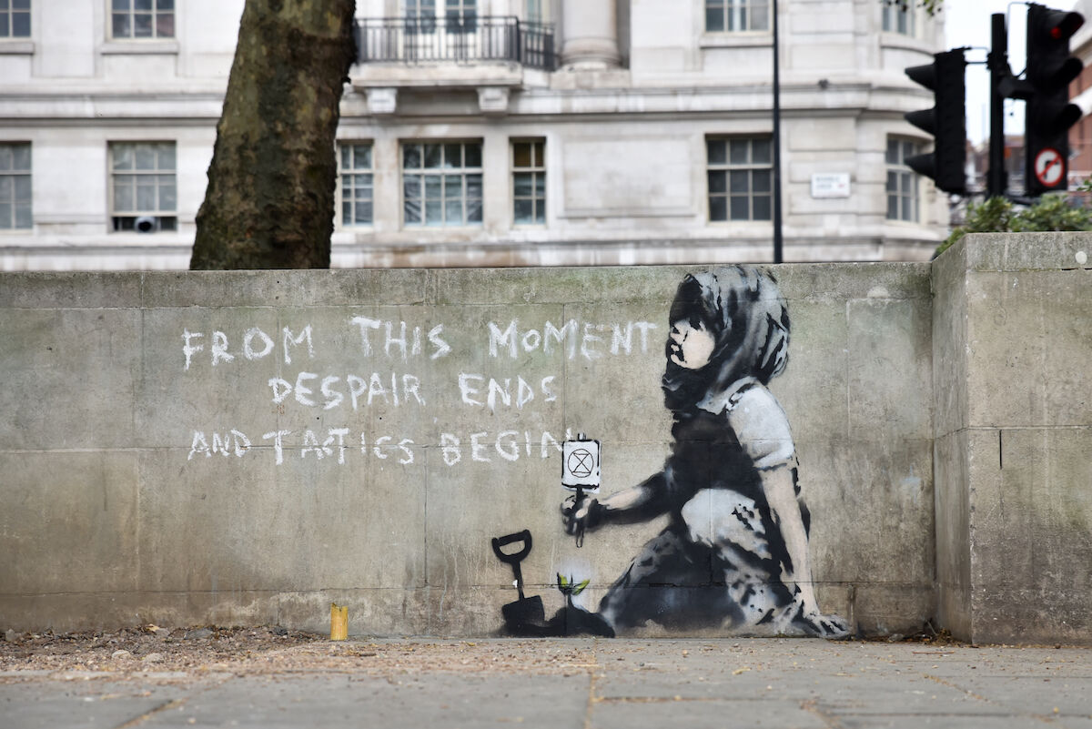 A mural believed to be by Banksy next to Marble Arch in London. Photo by Matthew Chattle / Barcroft Images / Barcroft Media via Getty Images.