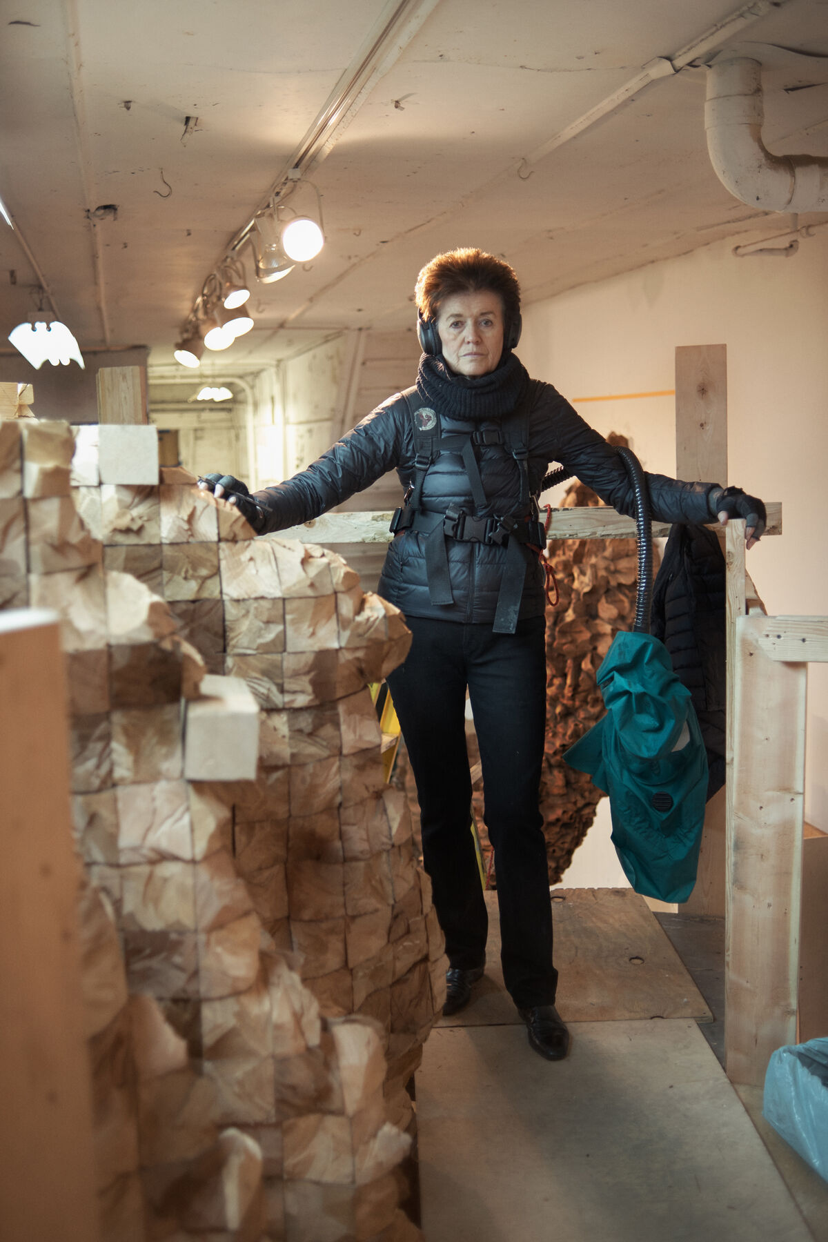 Portrait of Ursula von Rydingsvard in her Bushwick studio by Alex John Beck for Artsy.