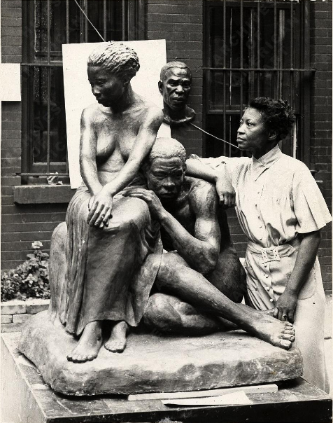 Augusta Savage with her sculpture Realization. Photograpy by Herman. Image viaFederal Art Project, Photographic Division, Smithsonian National Archives of American Art.