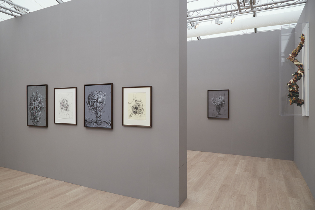 Works by Glenn Brown at Gagosian's booth at Frieze London, 2015. Photo by Benjamin Westoby for Artsy.