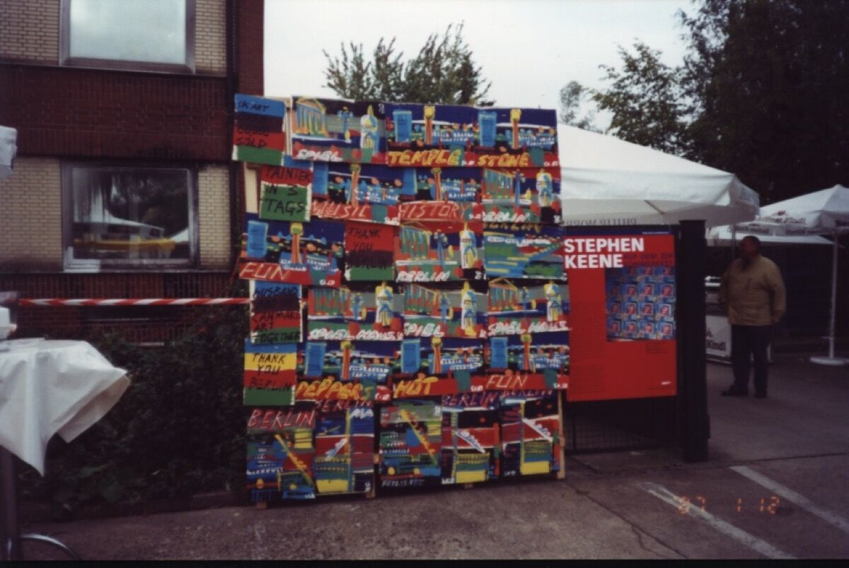 An outdoor display of paintings by Steve Keene during Octoberfest in Berlin, 2000. Photo courtesy of the artist.
