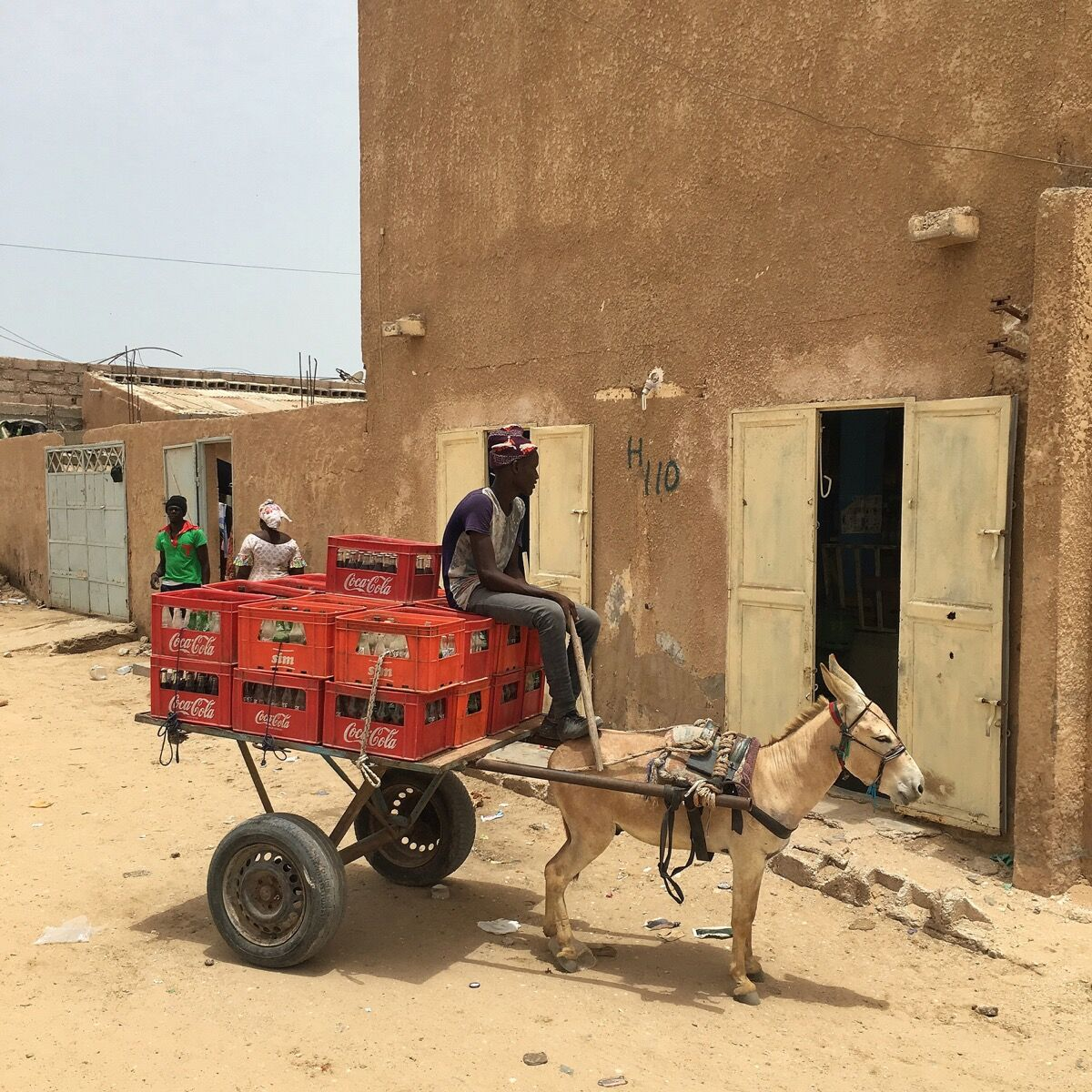 Aziz makes Coca-Cola deliveries with his donkey in Nouakchott, Mauritania. Photo by @dcoreraphotography.