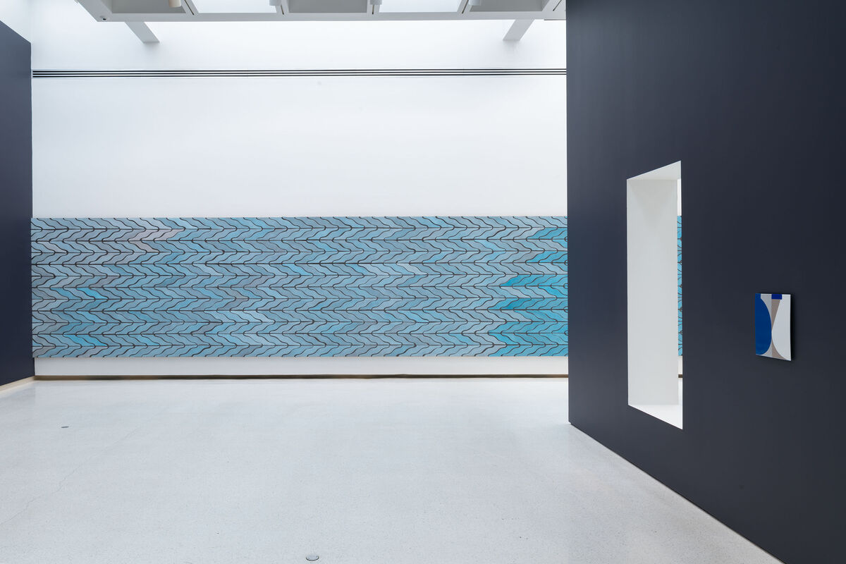 Installation view of Sarah Crowner, Wall (Wavy Arrow Terracotta), 2018, 57th Carnegie International. Photo by Bryan Conley. Courtesy of the artist and Casey Kaplan Gallery, New York.