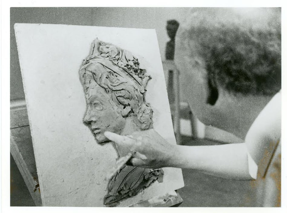 Arnold Machlin working on a clay model, 1967.© Royal Mail, courtesy of The Postal Museum.