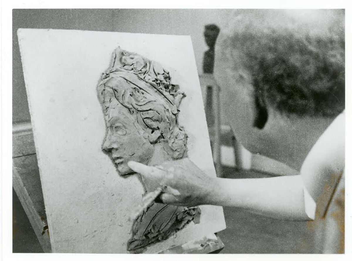 Arnold Machlin working on a clay model, 1967. © Royal Mail, courtesy of The Postal Museum.