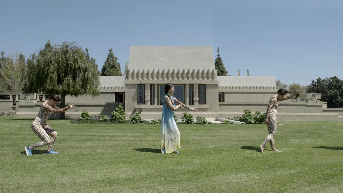 Video still of Clarissa Tossin, Maya Blue, 2017. Choreography / Performer: Crystal Sepúlveda, Image courtesy of the artist, Hollyhock House West Lawn, Barnsdall Park.