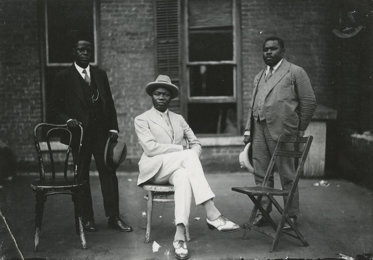 James Van Der Zee, Marcus Garvey with George O. Marke and Prince Kojo Tovalou-Houénou, 1924. © Donna Mussenden Van Der Zee. Courtesy of Howard Greenberg Gallery, New York.