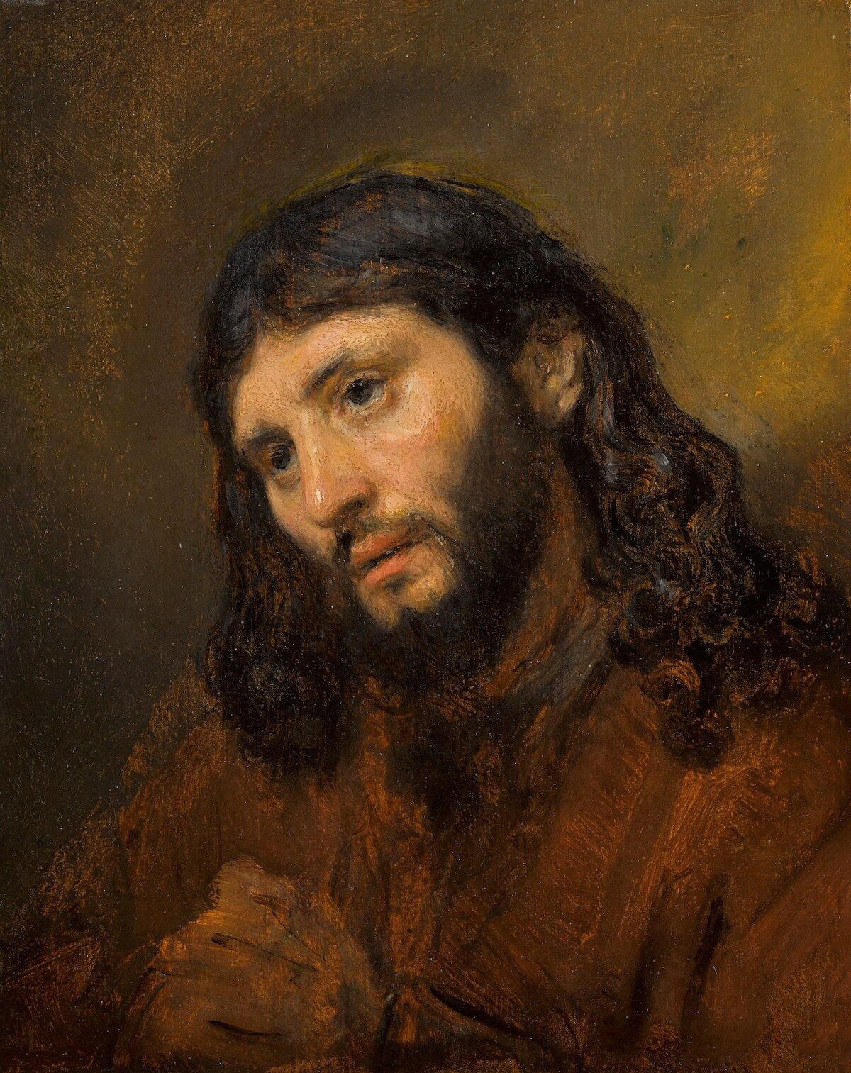 Rembrandt van Rijn, Head of a young man, with clasped hands: Study of the figure of Christ, c. 1648–56, oil on oak panel. Est. £6–8 million, sold for £9,480,800 at Sotheby's London in December 2018. Image courtesy Sotheby's.